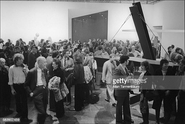 View of a crowd at the Whitney Museum for the opening of Mark de Suvero exhibition, New York, New York, November 17, 1975.