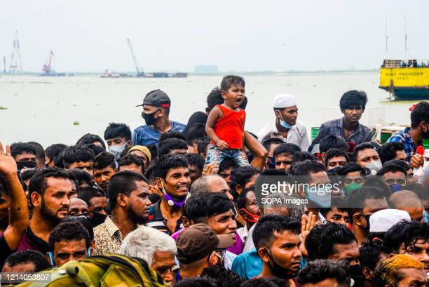 View of a crowd of migrant people ready to travel home for Eid al-Fitr amid Coronavirus crisis. Migrants flock at the Shimulia-Kathalbari ferry...