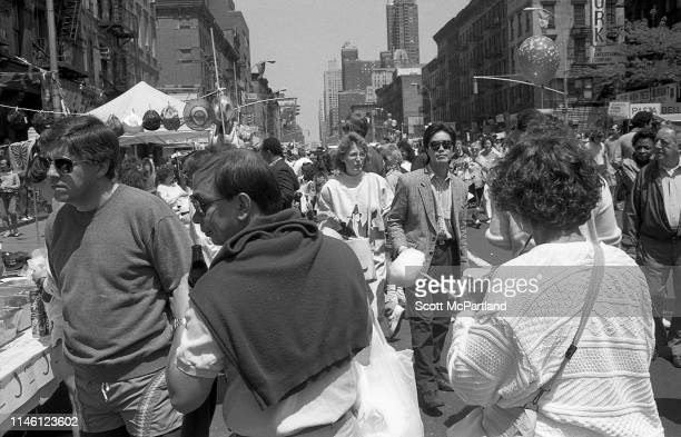 View of a crowd on 9th Avenue in Hell's Kitchen during the International Food Festival New York New York May 14 1988