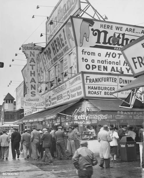 View of a crowd outside Nathan's Famous hot dog stand on Coney Island New York New York May 11 1954