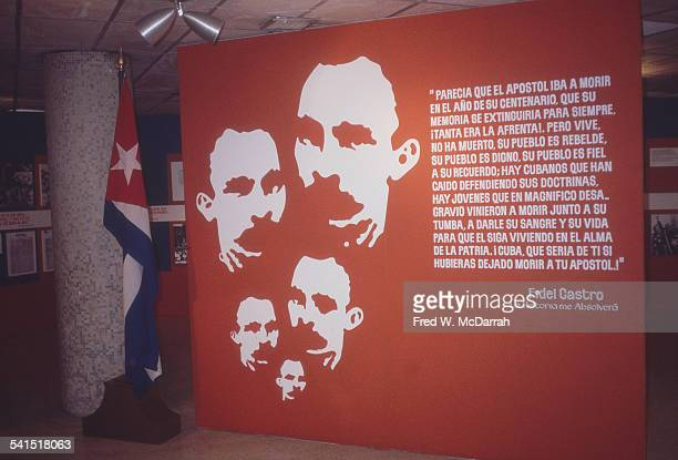 View of a Cuban history display inside Jose Marti International Airport, Havana, Cuba, January 26, 1983. A large poster includes images of, and a...
