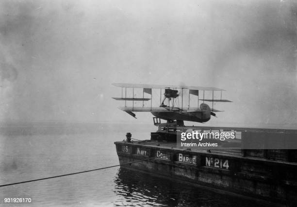 View of a Curtiss C2 flying boat on the catapult launch of US Navy Coal Barge 214 at Naval Aeronautic Station Pensacola Pensacola Florida early 1910s