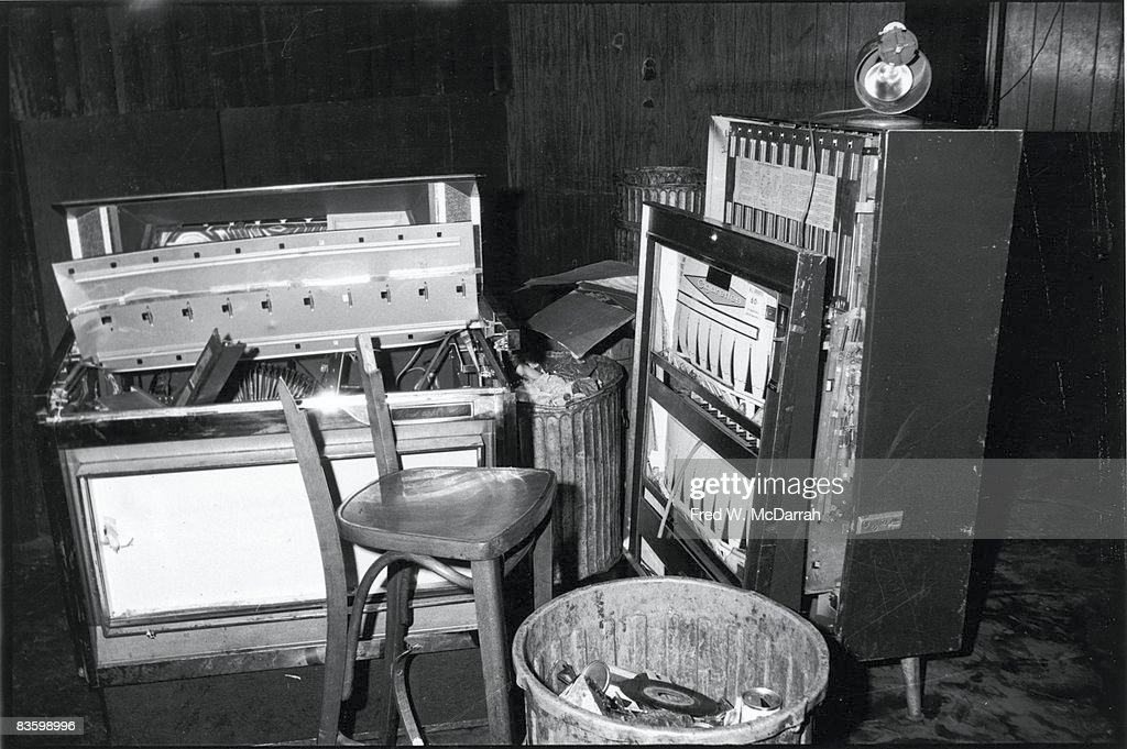 View of a damaged jukebox and cigarette machine, along with a broken chair, inside the Stonewall Inn (53 Christopher Street) after riots over the weekend of June 27, 1969. The bar and surrounding area were the site of a series of demonstrations and riots that led to the formation of the modern gay rights movement in the United States.