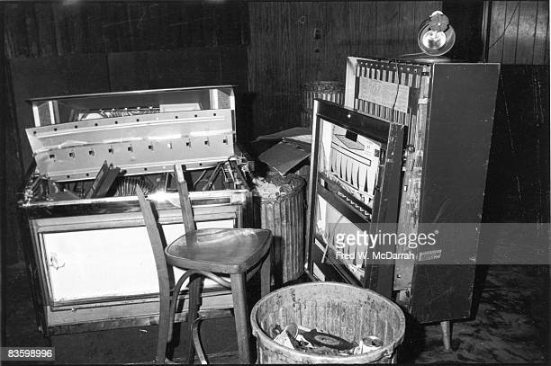 View of a damaged jukebox and cigarette machine along with a broken chair inside the Stonewall Inn after riots over the weekend of June 27 1969 The...