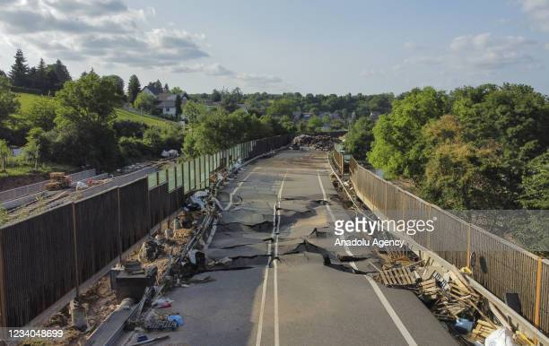 View of a damaged road after severe rainstorm and flash floods hit western states of Rhineland-Palatinate and North Rhine-Westphalia in Bad...