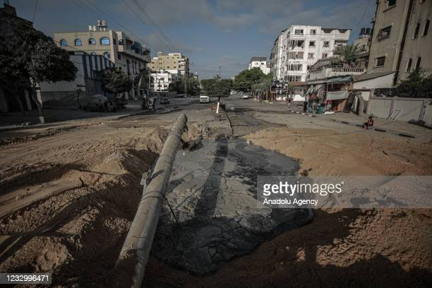 View of a damaged street is seen after Israeli airstrike in Gaza City, Gaza on May 20, 2021.
