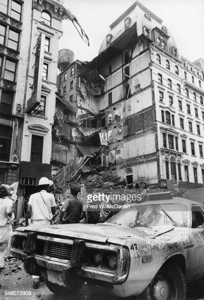 View of a damaged taxi cab that had been parked in front a collapsed section of the University Hotel New York New York August 3 1973 Emergency...