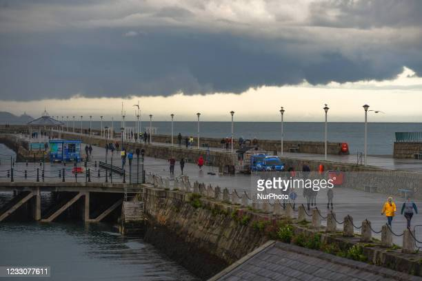 View of a dark sky and approaching storm over at Dun Laoghaire EastPier. On Sunday, 23 May 2021, in Dun Laoghaire, Dublin, Ireland.