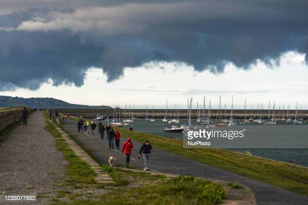 View of a dark sky and approaching storm over at Dun Laoghaire West Pier and Marina. On Sunday, 23 May 2021, in Dun Laoghaire, Dublin, Ireland.
