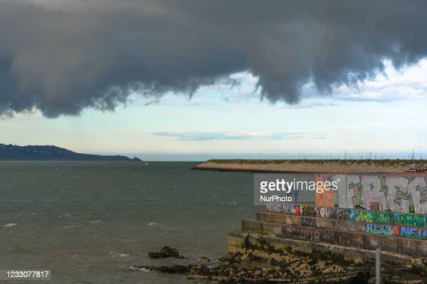 View of a dark sky and approaching storm over at Dun Laoghaire West Pier. On Sunday, 23 May 2021, in Dun Laoghaire, Dublin, Ireland.