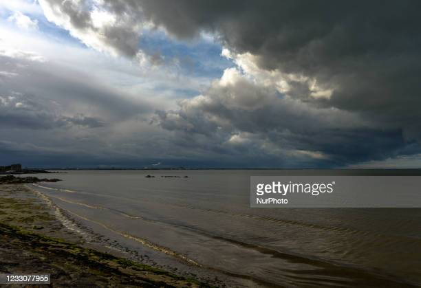 View of a dark sky and approaching storm over Dublin Bay seen from Seapoint Beach. On Sunday, 23 May 2021, in Dublin, Ireland.