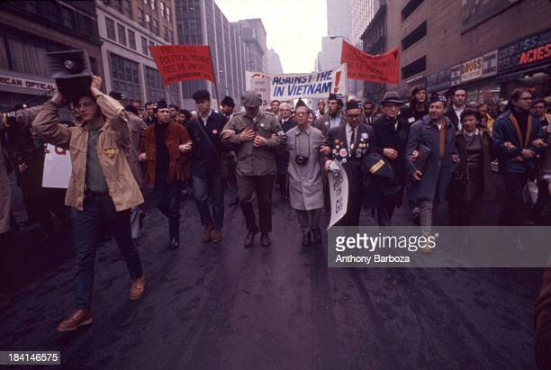 View of a demonstrators, including several veterans, as the march along a street during a protest against the Vietnam War, New York, New York, 1968.