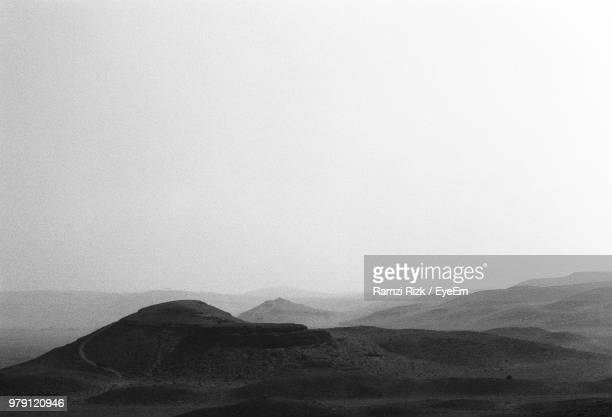 view of a desert - desaturated stock pictures, royalty-free photos & images