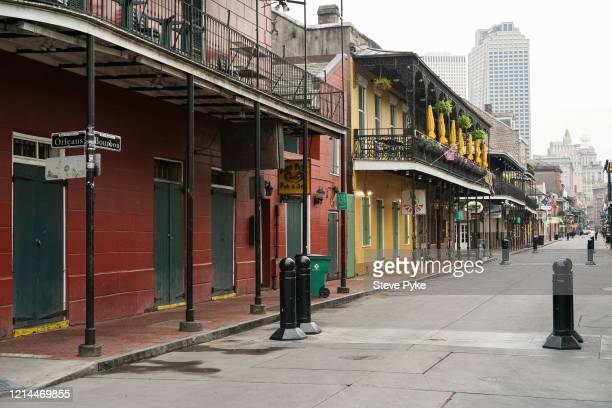 A view of a deserted Bourbon Street viewed from the corner with Orleans Street in the French Quarter of New Orleans amid restrictions in place to...