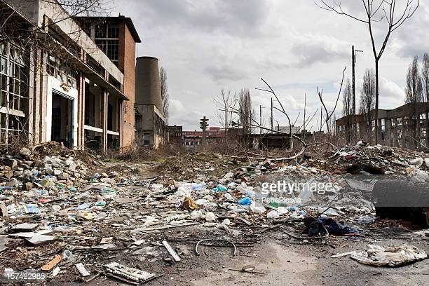 a view of a destroyed factory courtyard - bombing stock pictures, royalty-free photos & images