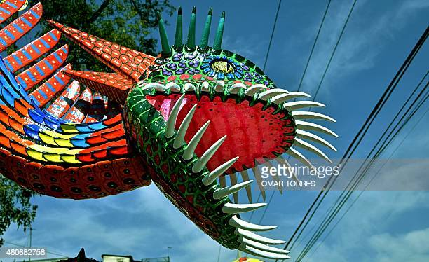 View of a detail of an Alebrije brightly colored papiermache sculpture of fantastical creatures during an exhibition at a street in Mexico Ciy on...