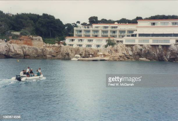 View of a dinghy as it approaches the EdenRoc Restaurant Cap d'Antibes France May 1993 Among the passengers are American film producer Harvey...