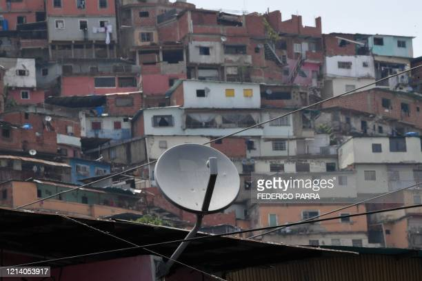 View of a DirecTV dish antennas installed on a house at the Petare neighborhood in Caracas on May 19 2020 US telecommunications giant ATT announced...