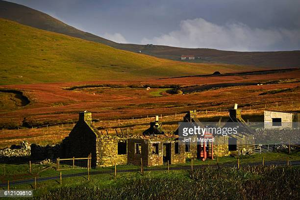 A view of a disused cottage and telephone box on the Island of Foula on September 29 2016 in Foula Scotland Foula is the remotest inhabited island in...