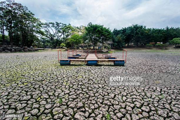 TOPSHOT View of a dock at the dried lake of the Peace Park in San Jose on May 14 2019 The lake was affected by droughts produced by El Nino...
