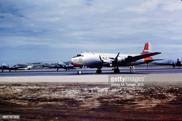 View of a Douglas C54 Skymaster transport plane parked on a runway Seoul South Korea July 1952