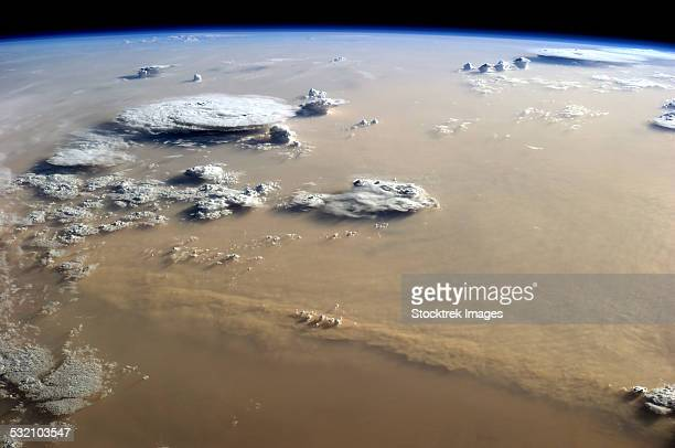 View of a dust storm that stretches across the sand seas of the Sahara Desert.
