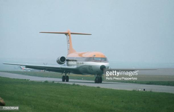 View of a Dutch built Fokker F282000 Fellowship civilian jet aircraft taxiing along a runway at Le Bourget Airport during the 1971 Paris Air Show in...