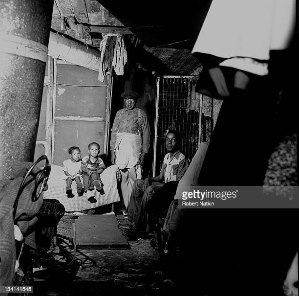 View of a family living in a slum neighborhood in Chicago 1952 This was an example of the kind of dwelling targeted for demolition by the Chicago...