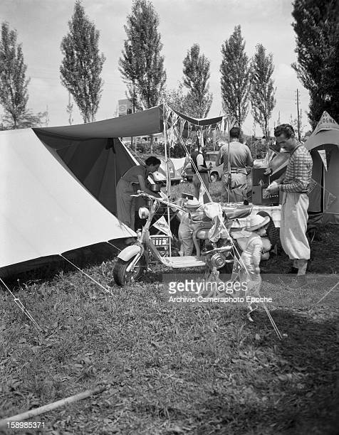 View of a family outside their tent at a campsite Padova Italy 1950