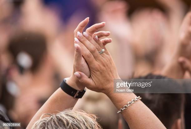 A view of a fan clapping at ABC's 'Good Morning America' at Rumsey Playfield Central Park on July 6 2018 in New York City