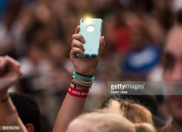 A view of a fan holding up a phone at Elvis Duran's 2017 Summer Bash at the Pennsy Plaza on July 27 2017 in New York City