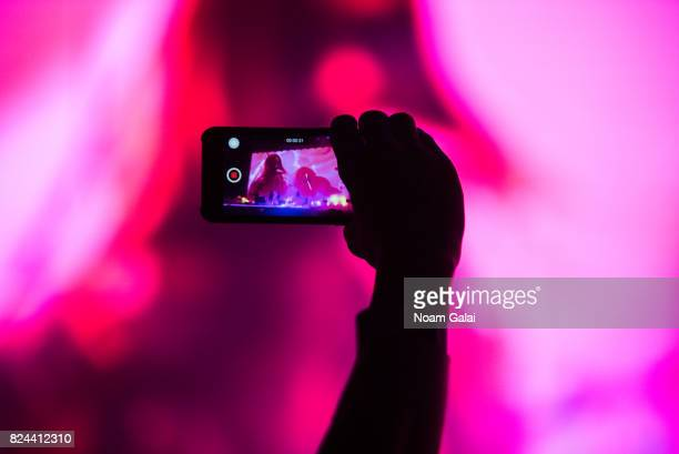 A view of a fan holding up a phone at the 2017 Panorama Music Festival at Randall's Island on July 29 2017 in New York City