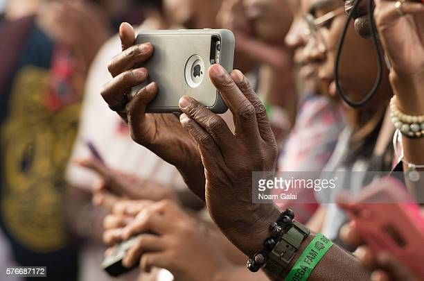 A view of a fan holding up a phone during the 12th Annual Brooklyn Hip Hop Festival finale concert at Brooklyn Bridge Park on July 16 2016 in New...