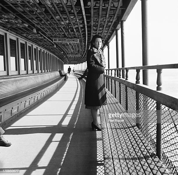 View of a female passenger standing near the railing on the deck of the Staten Island ferry New York New York 1948
