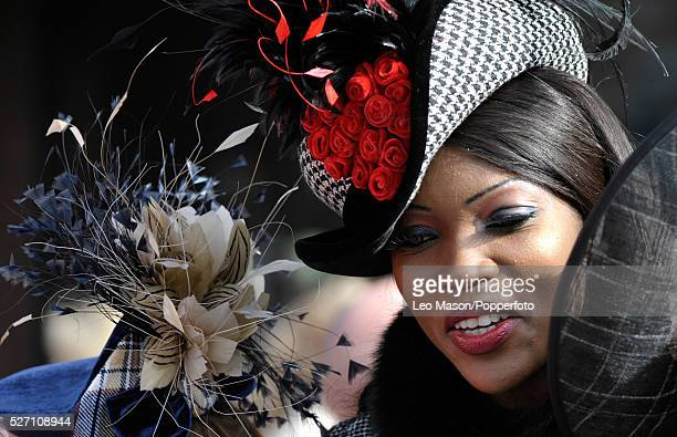 View of a female racing fan pictured wearing a hat on Ladies Day during the 2012 Cheltenham National Hunt Festival at Cheltenham racecourse in...