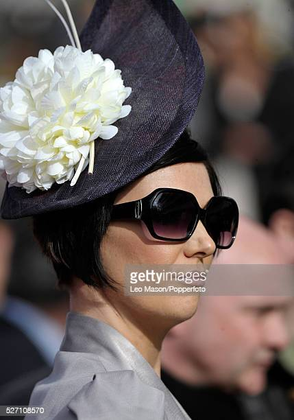 View of a female racing fan pictured wearing an exotic hat and sunglasses on Ladies Day during the 2012 Cheltenham National Hunt Festival at...