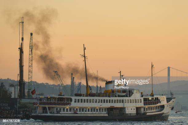 A view of a ferryboat carrying passengers from Beyoglu area to Eminonu area at sunrise On Tuesday 17 October 2017 in Istanbul Turkey