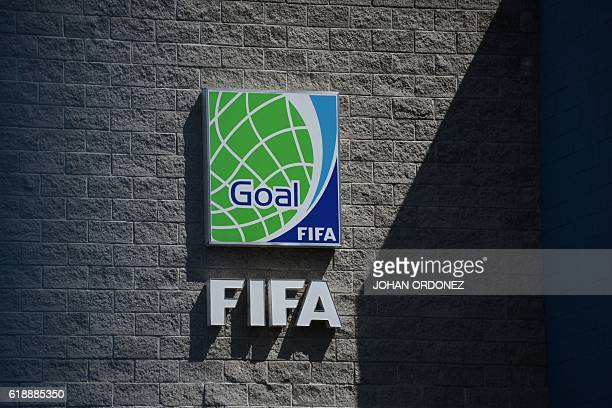View of a FIFA logo at the main entrance of the Football Federation of Guatemala headquarters in Guatemala city on October 28 2016 FIFA announced...