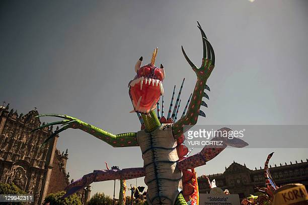 View of a figure on a float during the Fifth Monumental Alebrijes Parade on October 22 2011 in Mexico City Some 250 Alebrijes brightly colored...