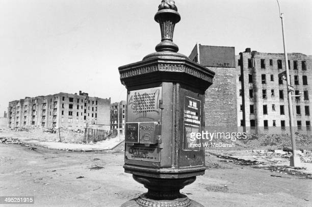 View of a fire and police department call box on a vacant lot in the Bronx at the intersection of East 170th Street Charlotte Street and Seabury...