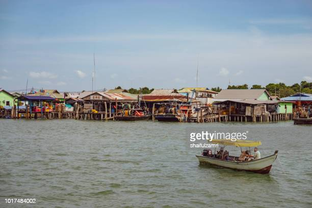 A view of a fishermen's village on stilts besides the sea in Pulau Ketam (Crab Island). Majority of the community in here works as fisherman or related activities such as producing sea food products or manage a sea food restaurants.