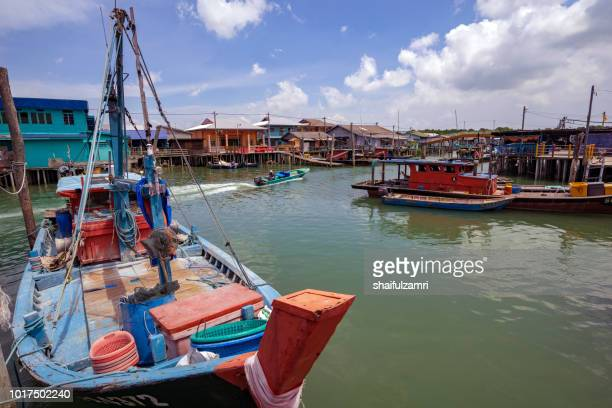 A view of a fishermen's village on stilts besides the sea in Pulau Ketam (Crab Island). This island is famous for sea food products and restaurants.