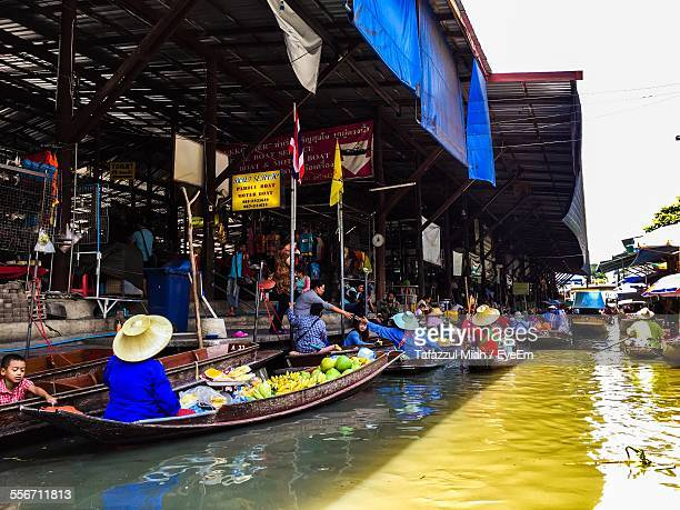 view of a floating market - floating market stock photos and pictures