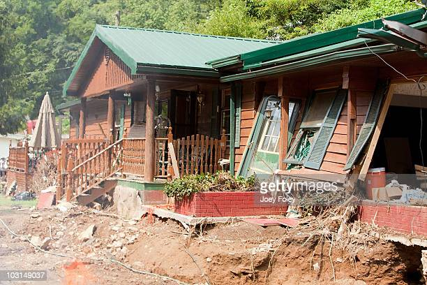 A view of a flood victim's house and the devastation still remaining from the flood disaster in Pike County The Tide's Loads Of Hope mobile laundry...