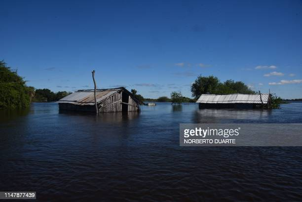 TOPSHOT View of a flooded area in Alberdi 140 km south of Asuncion on June 3 after unusual heavy downpours in the past month caused the overflowing...
