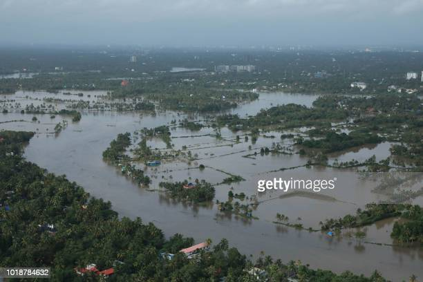 View of a flooded area is pictured in the north part of Kochi in the Indian state of Kerala on August 18 2018 Rescuers in helicopters and boats...