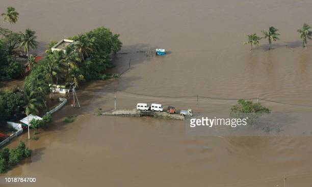 TOPSHOT View of a flooded area is pictured in the north part of Kochi in the Indian state of Kerala on August 18 2018 Rescuers in helicopters and...