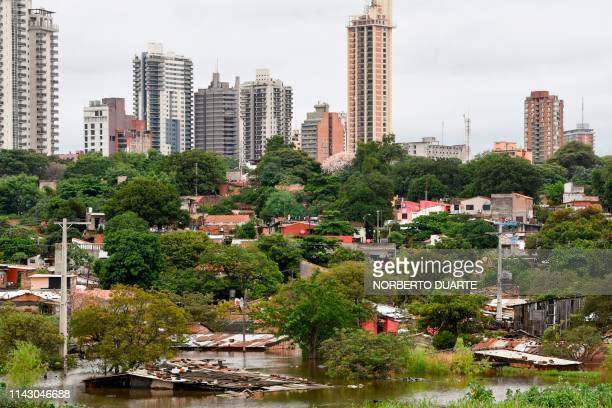 View of a flooded area of Asuncion on May 11 after the overflowing of the Paraguay River due to heavy rain in the past weeks Heavy rains that fell...