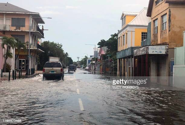 View of a flooded street in downtown Nassau on September 3, 2019. - At least seven people have been killed in the Bahamas by Hurricane Dorian, Prime...