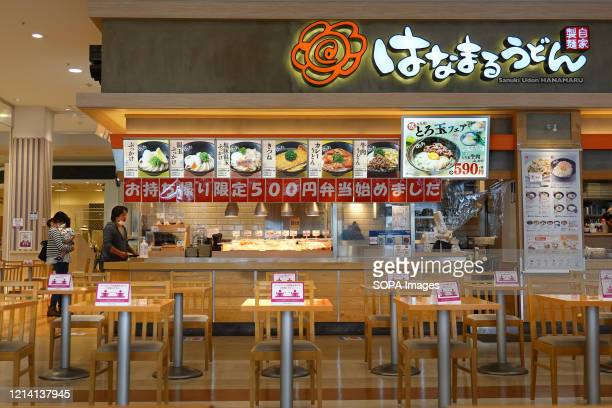 View of a food court shows the tables and chairs set up at a social distance as a preventive measure during the coronavirus pandemic. Tokyo, Osaka...